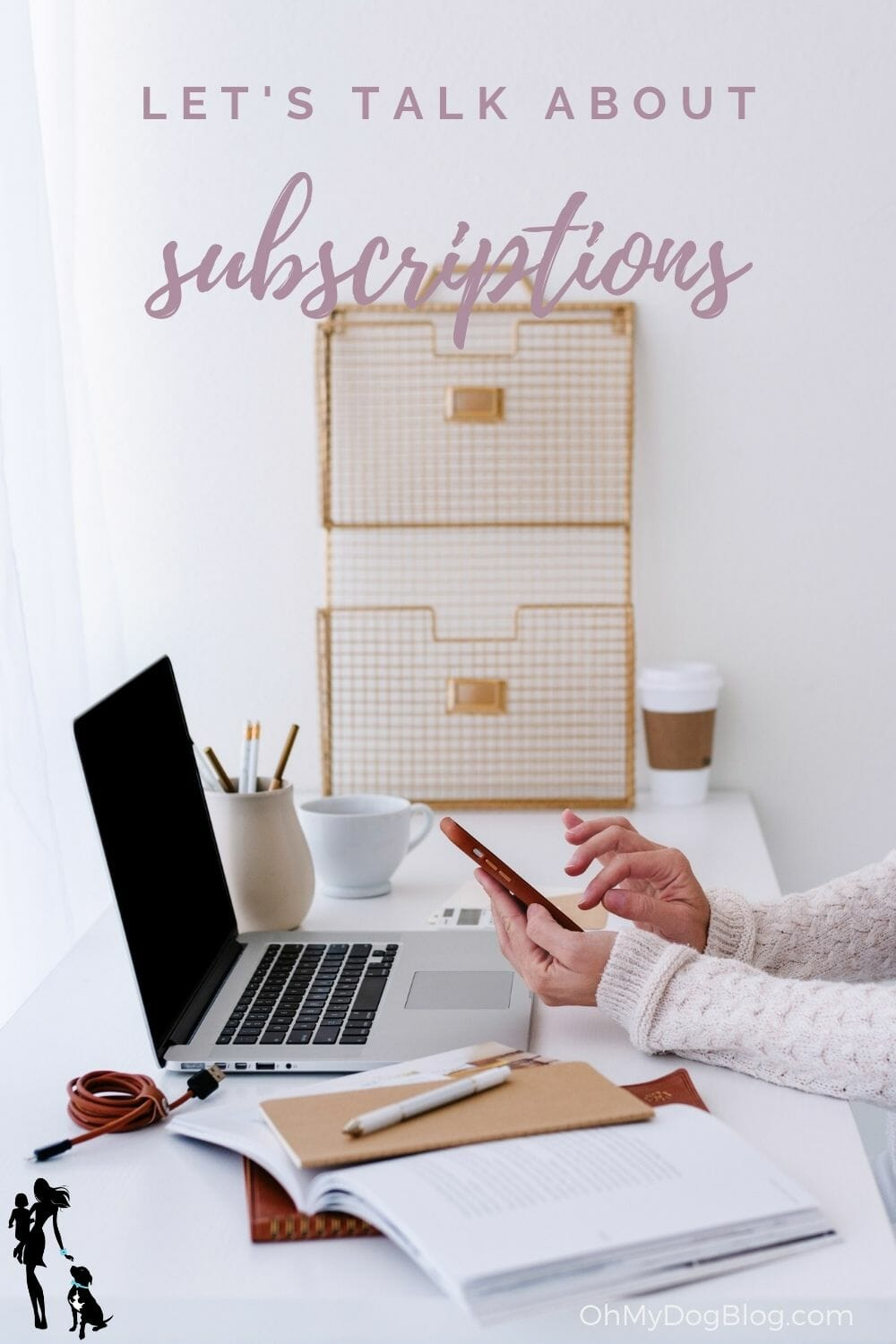 A desktop with a laptop, pen jar, coffee cup, and pile of notebooks. A woman's hands type at a smartphone off to the side. The text overlay reads: Let's talk about subscriptions.